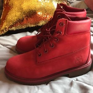 Red Timberland boots. Size 5 in women.